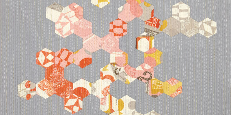 """Detail of """"More Than Twenty-three Hexagons"""" by Catherine Redford featuring matchstick quilting."""
