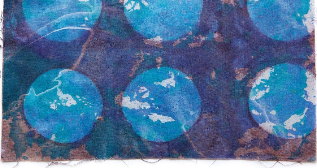 Lynn Krawczyk uses pressure as a dye resist in this fabric sample.