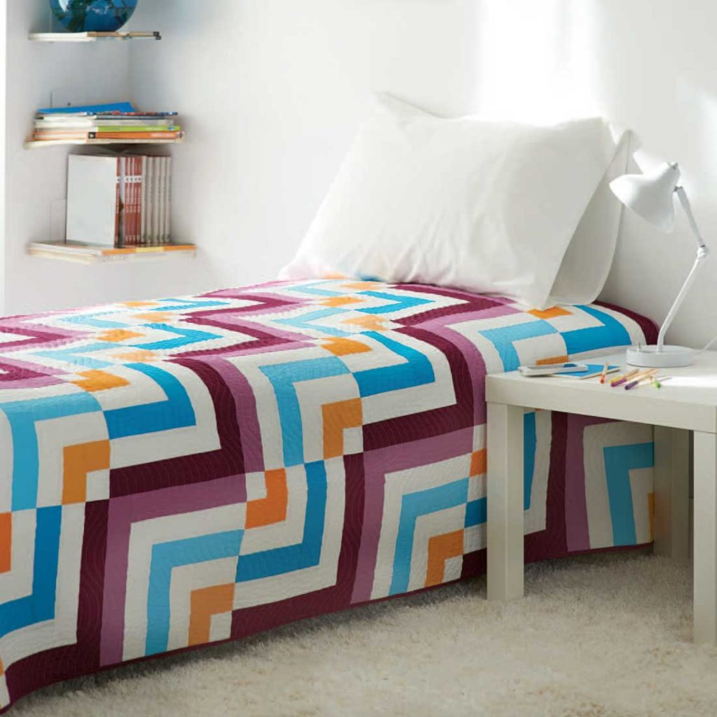Break out your jelly rolls for this modern take on a log cabin quilt.