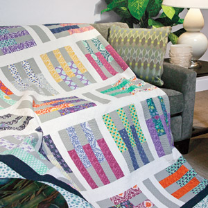 Pick-Up Sticks: Jelly Roll Precut Fabric Strip Lap Quilt Pattern ... : pre cut quilt patterns - Adamdwight.com