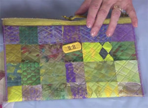 Tablet cover created by Susan out of a variety  of embellished interfacing that was woven  together, fused, and quilted.