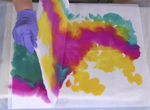Check the bottom layer of interfacing to see how it's absorbing color periodically as you paint.