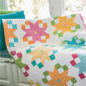 Star Flowers: Easy Bright Lap Quilt Pattern Designed by CHRIS WARNICK