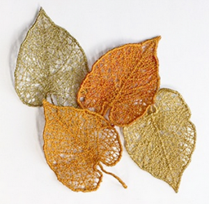 Amazing Lace Aspen Leaves reatedwith water-soluble stabilizer, metallic thread, and machine embroidery.