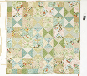 Cottage Whispers quilt pattern for precut fabric