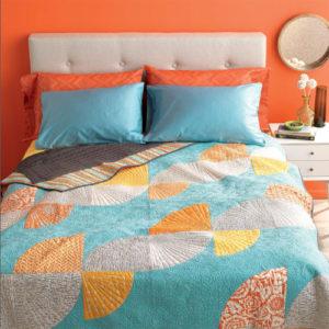 Orange Twist Quilt by Angela Pingel
