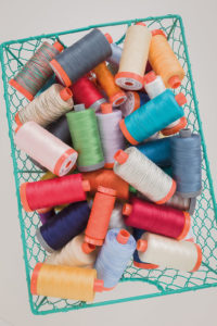 When domestic machine quilting, Christa Watson suggests using the same thread in the top and bobbin.