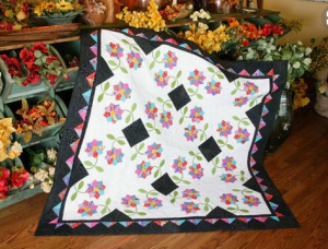 workshop wednesday whirling daisies 300x228 Workshop Wednesday: Fantastic Fat Quarter Quilts
