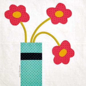 http://www.quiltedblooms.com