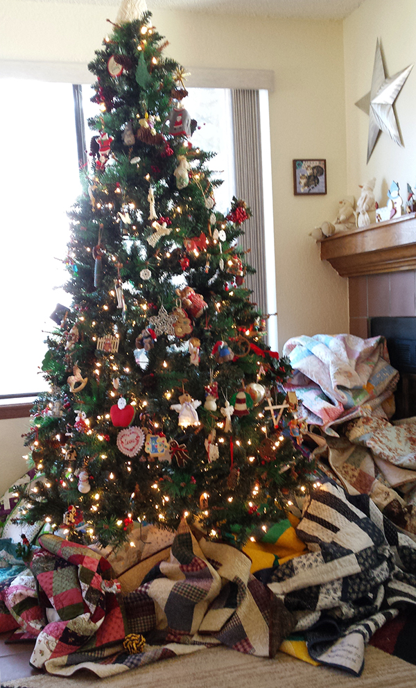 gifts our staff are making - Lori's pile of quilts, 2016