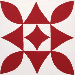 Red and white quilt block called Cactus Flower block by Linda Pumphrey
