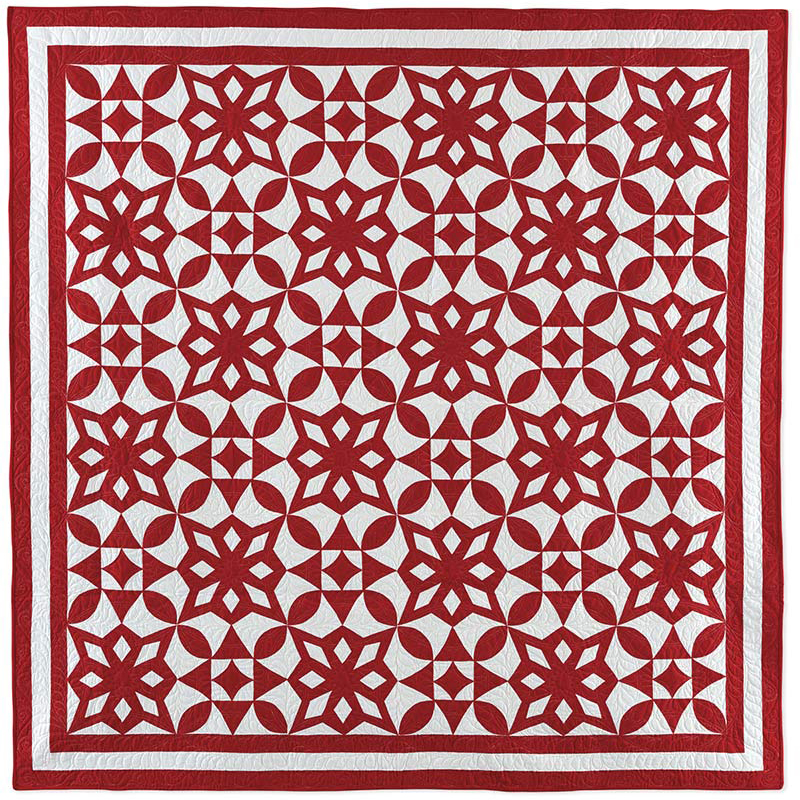 A red and white quilt by Linda Pumphrey called Winter Time Quilt