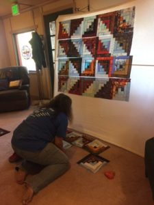 Ann staging a Log Cabin quilt top