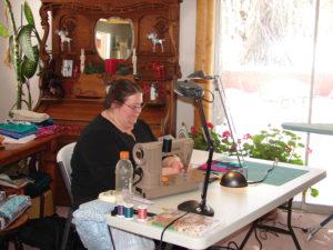 Beckie sewing at retreat