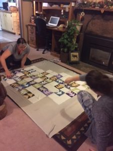 Lisa and Jesslyn arranging a quilt top