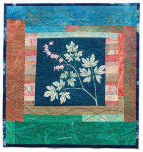 """Bleeding Heart"" an art quilt by Sue Reno featuring cyanotype fabrics."