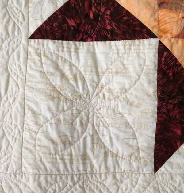 the same portion of the quilt after soaking it in Synthrapol twice