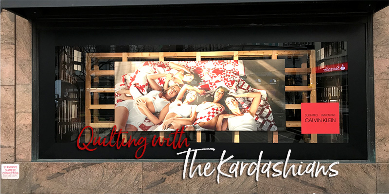 Macy's window display featuring the new Kardashian clan ad with Calvin Klein.