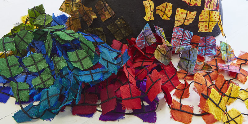 Use a grid and water soluble stabilizer to make this colorful scarf