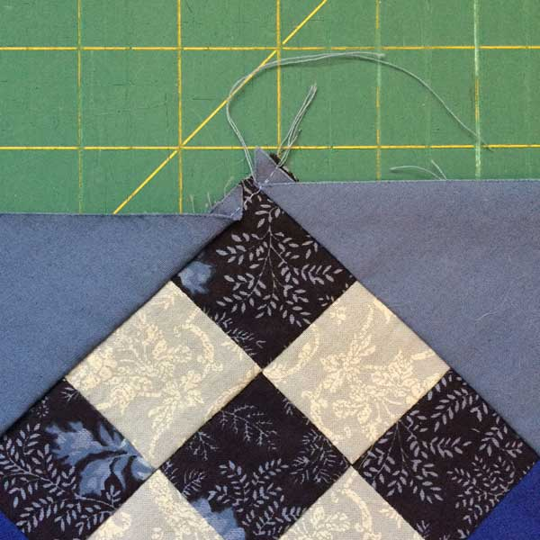 The worst example of the setting triangles not being cut or sewn properly to the blocks.