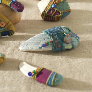 Talismans from cloth, beads, and found shells