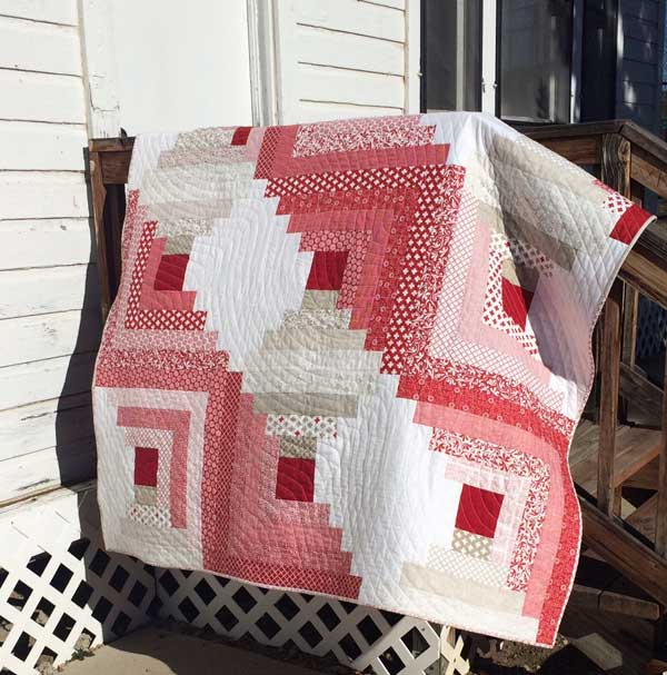 Project Red log cabin throw by Mary Kate Karr-Petras