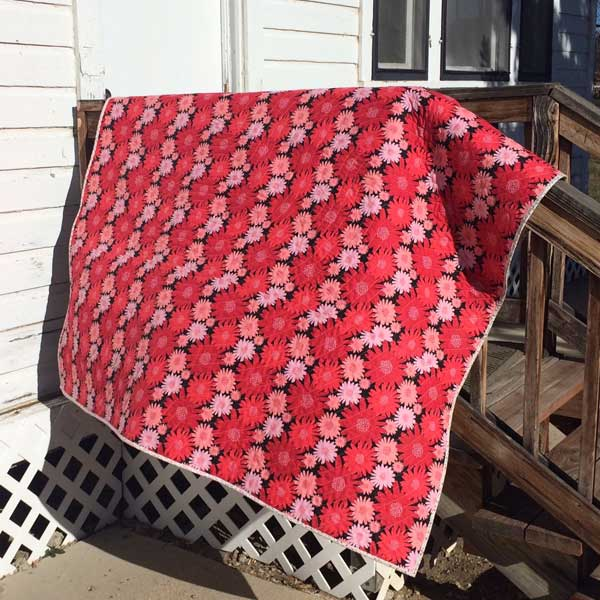 back of the log cabin quilt in Gerbera Red