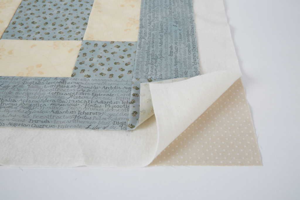 machine-quilting-take-time-to-prepare-quilt-sandwich