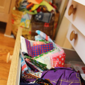 Drawer overflowing with scrap fabrics