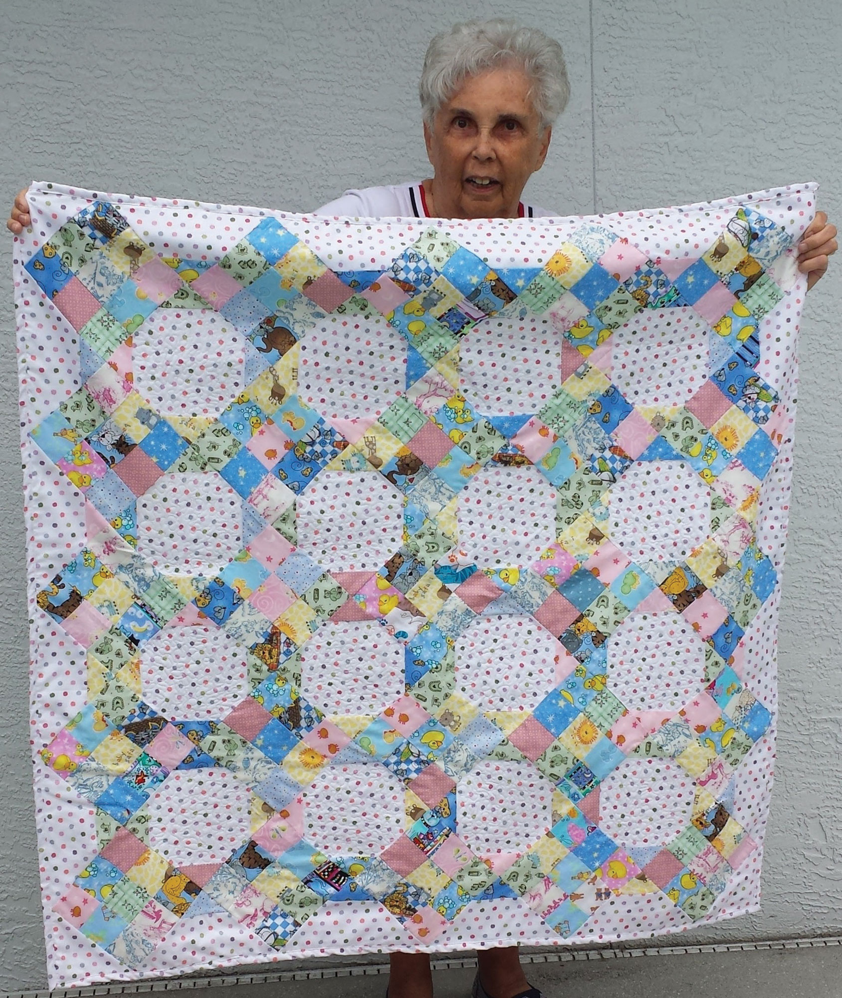 Lucretia Winters with her version of My Only Sunshine, from McCall's Quick Quilts Aug/Sept 2017