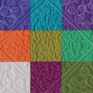A close up of a placemat quilted by Catherine Redford