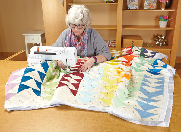 Catherine Redford quilting on her home machine.