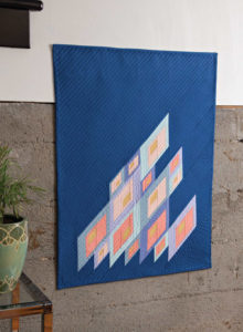 In this modern quilt Jen Sorenson uses parallelograms to create interest and depth.