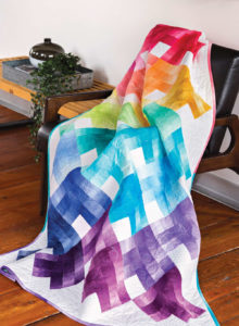 Melting Candy uses Quarter Log Cabin blocks and ombre fabric to create the effect of a candy rainbow.