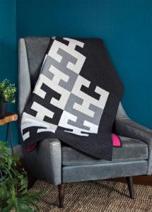 Inspired by interlocking floor tiles, Melanie Tuazon creates a unique modern quilt.