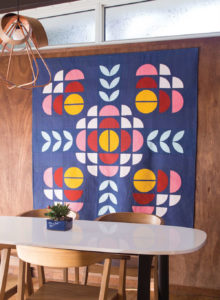 This modern quilt by Brigit Dermott is inspired by traditional Drunkard's Path and Medallion quilts.