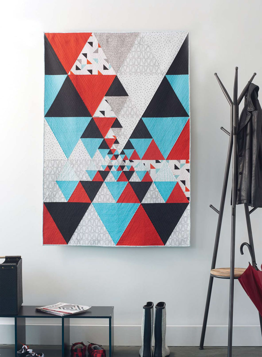 This dynamic modern quilt is a contemporary take on the traditional Thousand Pyramids.