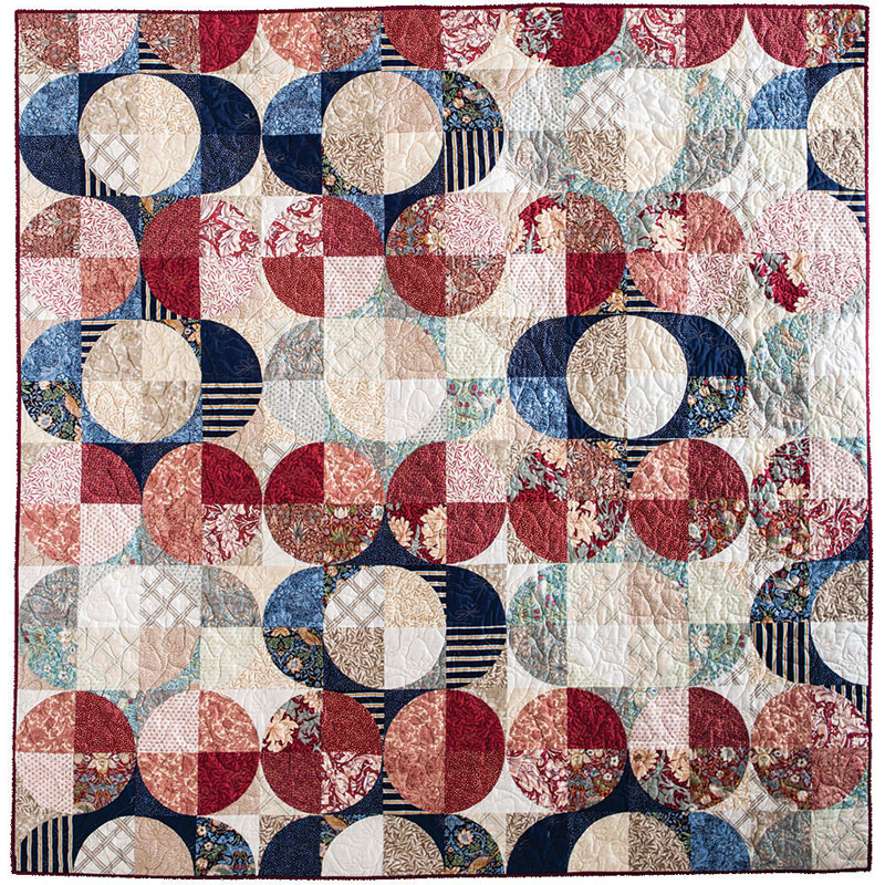 A modern quilt by Jen Carlton Bailly featuring fabric designed by William Morris.