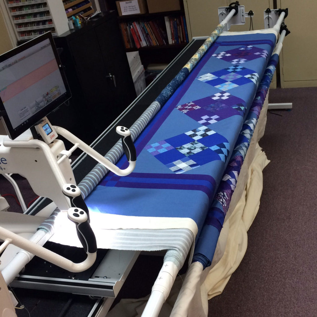 The longarm frame loaded and ready for quilting.