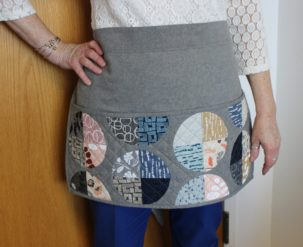 This quilted apron was designed by Jen Carlton Bailly.