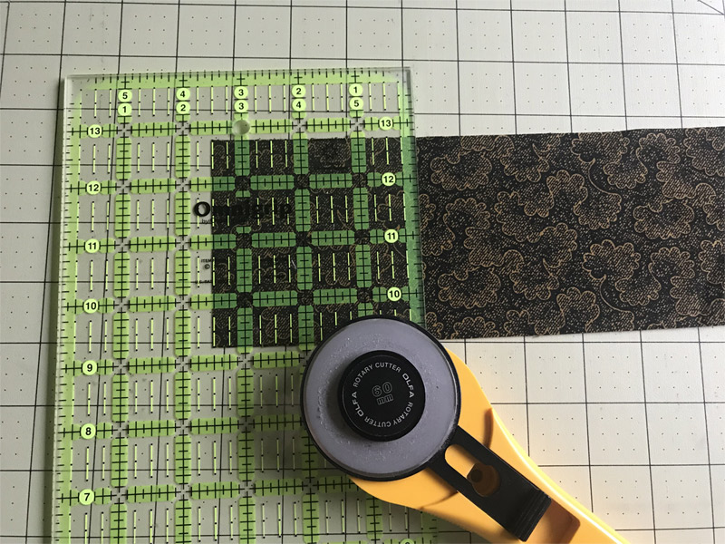 """Mystery Quilt Clue 5 - Cut 40 squares 3½"""" x 3½"""" from the 4 strips of dark fabric."""