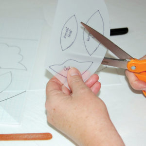 Cut the template out and smooth the edges using a nail file.