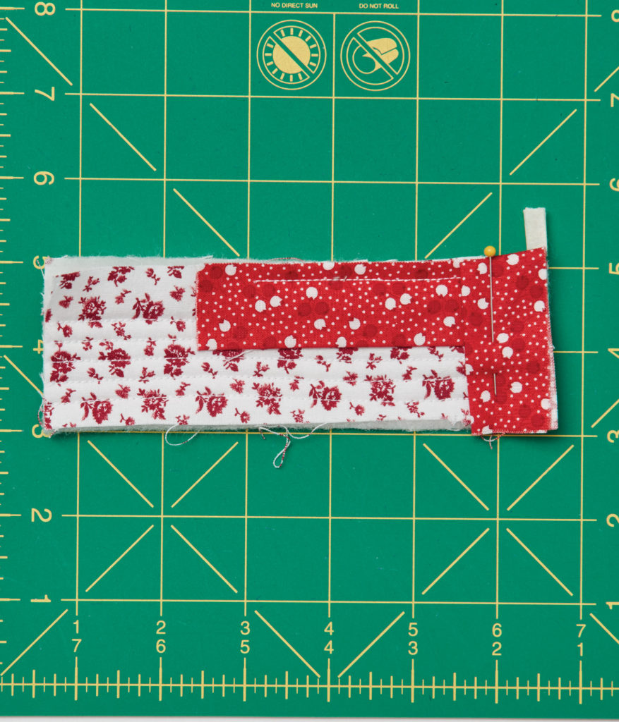 """a piece of ¼"""" tape on the corner can remind you where to stop sewing"""