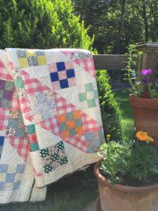 Heirloom Quilt featuring traditional quilt blocks owned by Vivika Hansen DeNegre