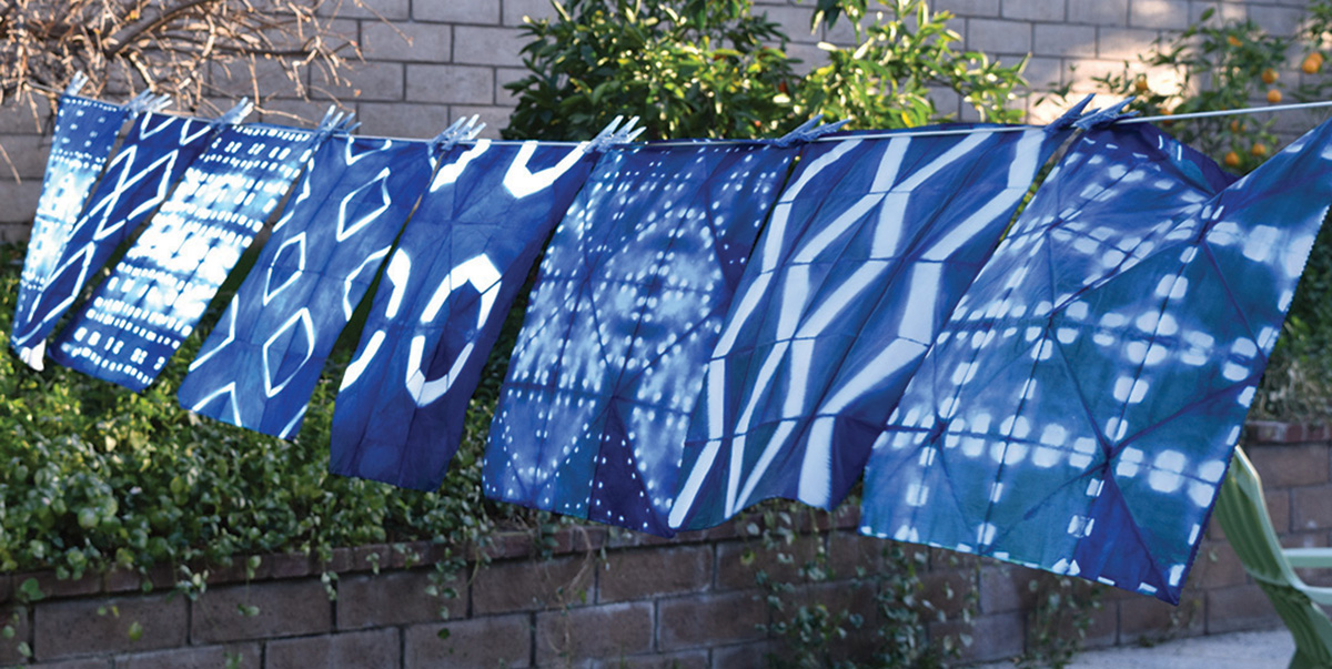 Itajime shibori dyed by Candy Glendening on display in her backyard.