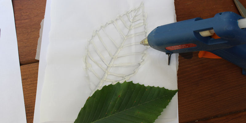 Leaf stencil I made using hot glue and Deborah Boschert's tutorial.