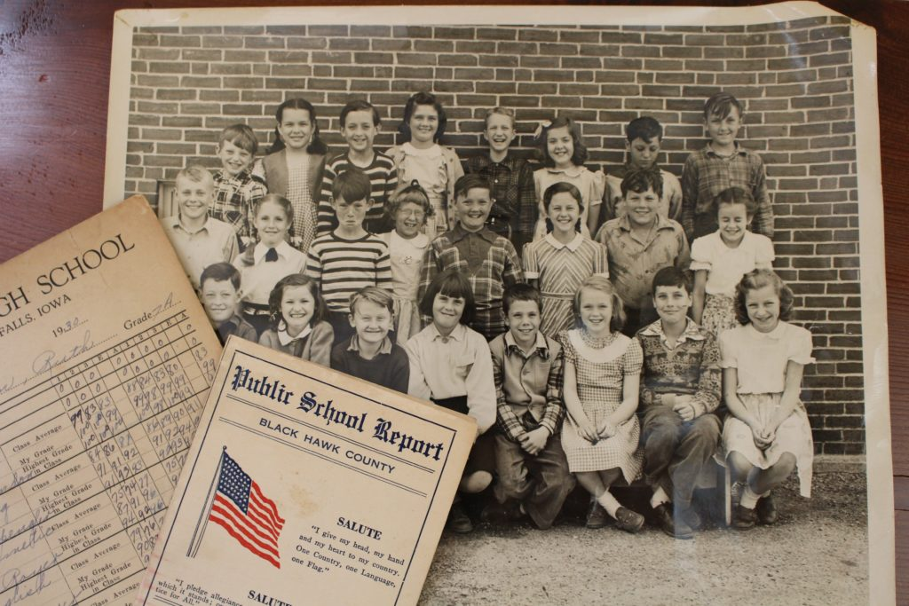 My mother's fourth-grade class photo and her mother's report cards.