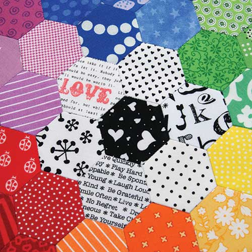 Close up of the Rainbow Hexagon Mini Quilt by Jemima Flendt