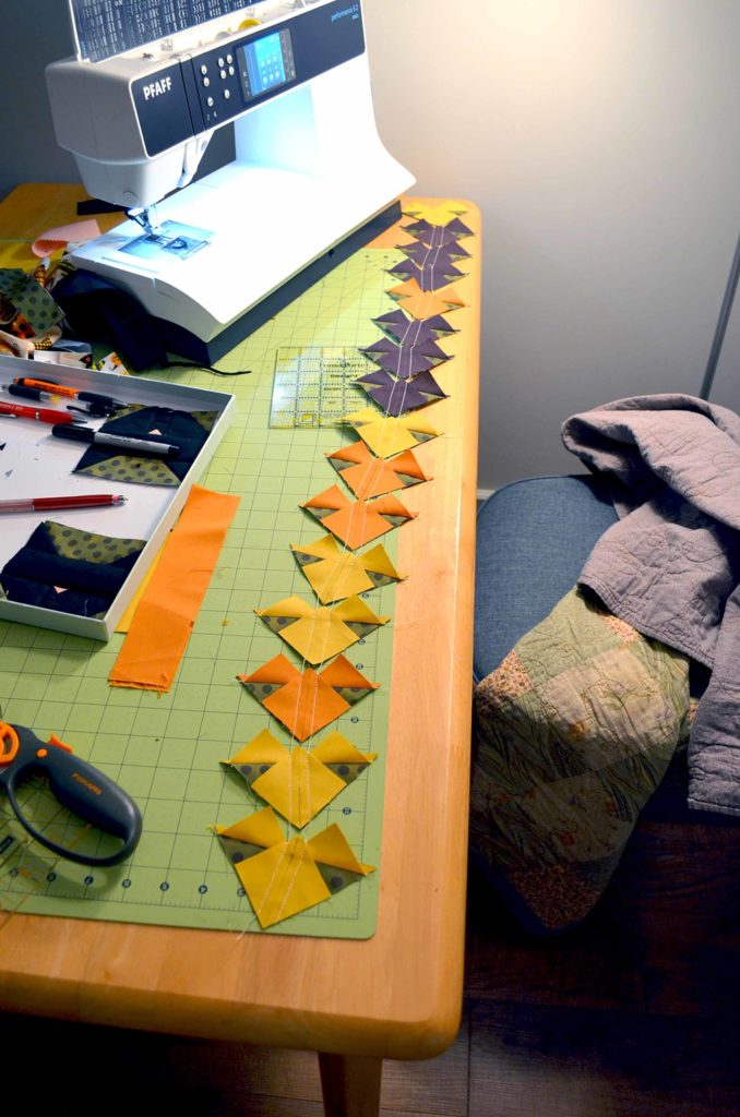 All in a row, these will soon be cut to reveal 32 Flying Geese units, and will be sewn into 8 coordinating Sawtooth Stars!