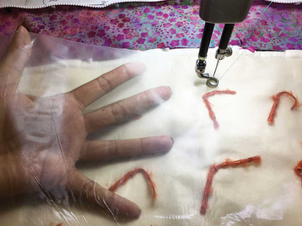 Water-soluble stabilizer can protect ties while machine quilting.